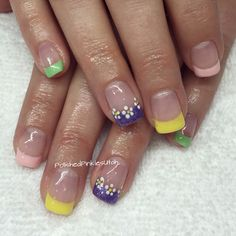 Polished Pinkies Utah: Spring fever nails! Multi color french manicure with white dot flowers makes for the perfect manicure to welcome in spring. Gel polish, gel nails, shellac, spring nails, summer nails, cute nails.