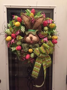 Easter wreath, poly burlap deco mesh, large bunny face,natural rabbit face, easter bunny wreaths, deco mesh, bunny head, chevron ribbon by RoesWreaths on Etsy https://www.etsy.com/listing/225757496/easter-wreath-poly-burlap-deco-mesh