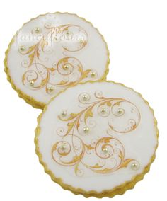 Filigree sugar cookies. These use edible paper... I want to try with simple royal icing.