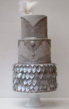 Silver tiered wedding cake, feathers, fondant, icing, decorated cakes, lace, leaves, leaf detailing, bling