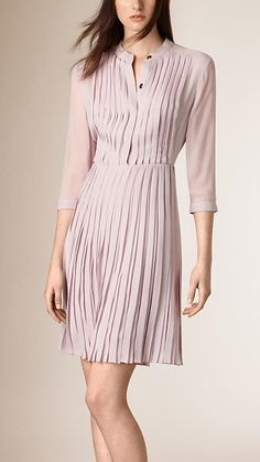 "Burberry collarless silk dress detailed with slim, structured pleats at the body and skirt. The design is complemented by a sheer back and mid-length sleeves. Discover the women's dress collection at <a href=""http://Burberry.com"" rel=""nofollow"" target=""_blank"">Burberry.com</a>"