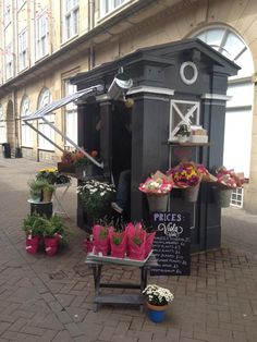 Police Box Flower Shop, Edinburgh. Nice additions such as awning and hanging brackets.