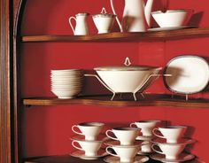Small dose, big impact: Eldon Wong used a rich saturated red (see next slide) on the back interior of the cupboard built into the dining room wall of this 18th-century stone house. The brilliant color perfectly accents a 1950s Rosenthal china service by Raymond Loewy.