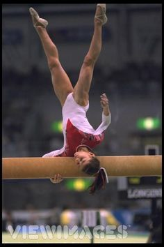 Dominique Moceanu...favorite gymnast ever!  I also love this mount!