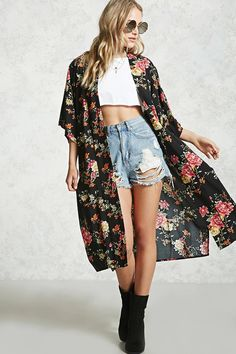 A woven cardigan featuring an allover floral print, an open-front, short sleeves with dropped shoulders, and side slit detailing.