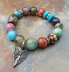 Safe Angel Beaded Stretch Bracelet,  Artisan Angel, stack bracelet, Artisan Jewelry, charm bracelet by JewelitCouture on Etsy https://www.etsy.com/listing/229790097/safe-angel-beaded-stretch-bracelet