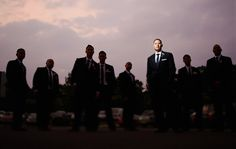 Groomsmen wedding photography idea - light the groom and put the rest of the guys in silhouette.