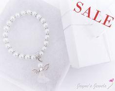 SEPARACIÓN, primera comunión pulsera, pulsera Angel, joyas comunión o confirmación, pulseras de perlas blanco, elección de Ángel o encanto cruz