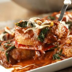 Juicy pork chops are sauteed to perfection and served with an appealing sauce made with marinara Italian sauce, frozen chopped spinach and onion, then topped with shredded mozzarella cheese.