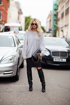 Casually cool in slouchy sweater teamed w/ Saint Laurent tassel bag & leather boots #StreetStyle