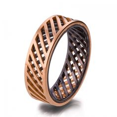 For the groom who likes to be different, this handmade wedding band by DoronMeravWeddings via etsy is made of solid 18k rose gold and oxidized sterling silver. #groomsring #mansweddingring