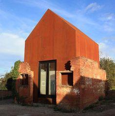 Modern Prefab Metal Home (Re)Mixes Brick, Wood & Steel