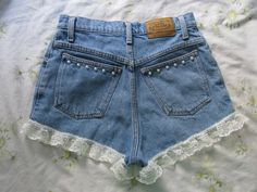 Adorable medium wash #denim #high #waist #shorts. Added embellishing -- #ruffles at the leg opening as well as #pearls on the butt pockets.   Measurements **laid flat**(inches): -waist 27'' -hips 35'' -rise 12'' -inseam (ruffle included) 2'' -leg opening 23''  #vintage #denim #shorts #highwaistedshorts
