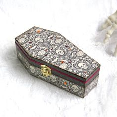 Halloween Coffin Box Decoupaged Halloween Coffin Trinket Box Goth Gothic Skulls Pumpkins Gray White Decorated Coffin Swarovski Crystal by rrizzart on Etsy https://www.etsy.com/listing/246798778/halloween-coffin-box-decoupaged