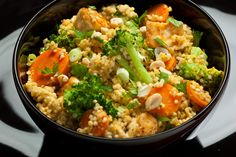 This spicy Thai-inspired vegan recipe has quinoa mixed together with coconut milk, broccoli, carrots, tofu, and a lime and Sriracha dressing.