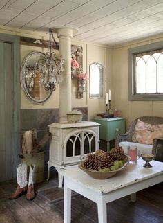 An eclectic mix of used furniture and accessories join together to make an adorable living room. abeautifulmess.blogspot.com