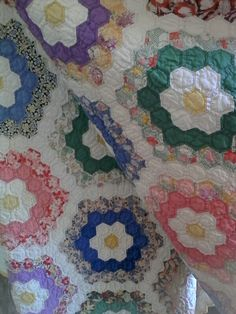 All time favorite, grandmothers flower garden. Hand pieced hand quilted from southern Indiana.