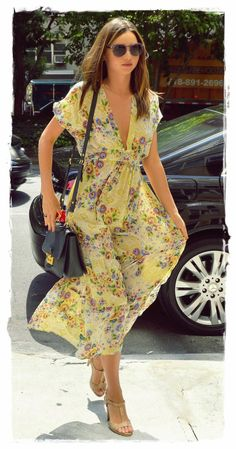 Miranda Kerr Street Style Snapshot - Floral Print Maxi |  The pretty wife of Orlando Bloom was effortlessly stunning as she recently performed some tasks in Manhattan. Showcasing a feminine-looking outfit, she chose to wear an elegant, floaty, floral dress which featured a sheer fabric and a plunging neckline.