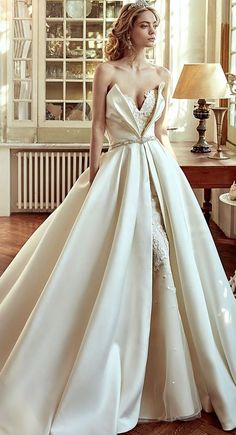 Uniquely glamorous ballgown wedding dress; Featured Dress: Nicole Spose