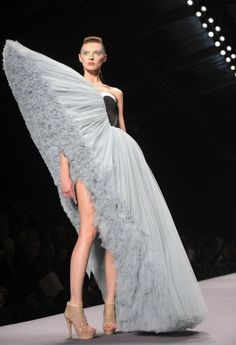 And no one even noticed her crooked leg  .......... by Viktor & rolf