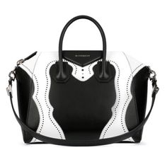 The iconic Givenchy Antigona bag in black and white with brogue detailing is an…