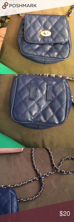 A Prada purse and a charming Charlie's purse A blue charming Charlie's cross over bag small but very cute Charming Charlie Bags Crossbody Bags