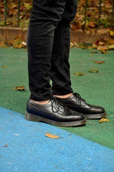 DR. MARTENS black shoes.