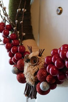 Awww... fuzzy yarn owl sitting on a branch of your wreath
