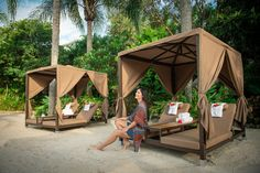 The all-inclusive Discovery Cove in Orlando is now offering a new way for guests to upgrade their experience by renting shaded luxury day beds: