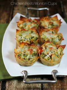 These Chicken Pesto Wonton Cups are a perfectly portioned and delicious muffin tin meal! Only 170 calories or 4 Weight Watchers SmartPoints each! www.emilybites.com