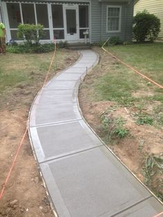 A brush finish is added to a concrete surface to give it traction and a standard appearance. Poured Concrete Patio, Concrete Patio Designs, Concrete Driveways, Stamped Concrete Walkway, Concrete Slab, Walkways, Front House Landscaping, Front Walkway, Driveway Landscaping