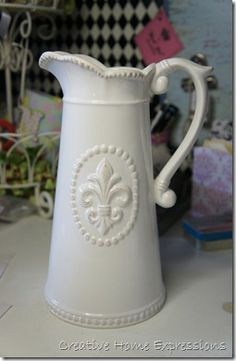 White fleur de lis pitcher- this would be so pretty, full of red and yellow flowers, on the mantle or kitchen table