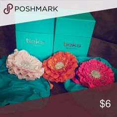 3 Tieks flowers, 2 shoe totes + 2 empty boxes Includes 3 flowers, 2 empty boxes and 2 packable teal totes for your shoes. No shoes included. None have been used for anything so in excellent/pristine shape. Tieks Other