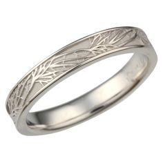 This is a matching wedding band to the Tree of Life Engagement Ring. A similar branch pattern repeats and overlaps around this ring. The recesses can be darkened to create contrast between the tree and background.