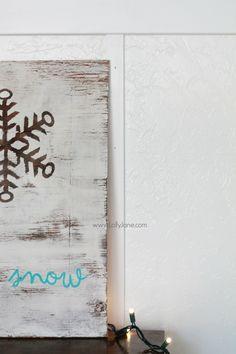 Pretty natural snowflake winter decor. This let it snow sign is so cute all season long. Cute Christmas decor!