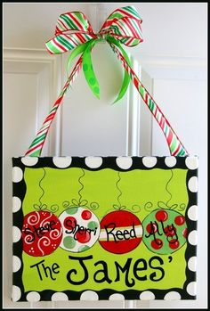 Adorable!! I want to make one of these for the door, but it'd have to fit 5 ornaments on it instead so when we decide on a name for the baby it can go on it as well.
