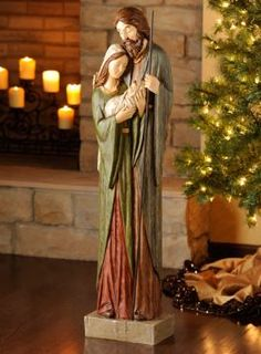 """""""Holy Family Nativity"""" - from Kirkland's;  This resin statue with a wood-carved look is bigger than you think:  45"""" tall x 10.5"""" long."""
