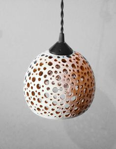 This one is our pride and joy. Our lights are forever evolving getting better & better. Our Hanging Pottery Lights are all made by hand on the potters