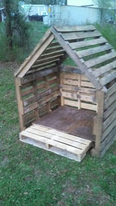Dog Door - Pallets then clad with ply stain on out side raise it up on piles put iron on roof a door a ladder paint in side out side lights on deck and make deck a bit bigger
