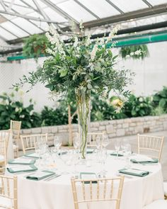 Tall wedding centerpieces make a major statement. See photos of some of the most beautiful towering centerpieces here. Green Centerpieces, Greenery Centerpiece, Tall Wedding Centerpieces, Wedding Flower Arrangements, Wedding Decorations, Centerpiece Ideas, Wedding Ideas, Wedding Inspiration, Tall Flower Arrangements