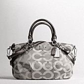 """madison op art sateen sophia satchel $298.00   style:17693 Subtle tonal texture adds a luxurious note to the simple, sophisticated shape of our elegant Sophia Satchel. Op Art sateen fabric with leather trim Inside zip, cellphone and multifunction pockets Zip-top closure, fabric lining Handle with 5"""" drop Longer strap for shoulder or crossbody wear 14 1/4"""" (L) x 9 1/2"""" (H) x 3 1/4"""" (W)     SILVER / GREY in stock"""