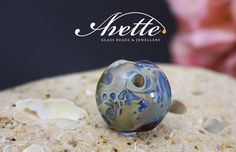 Majestic.  Lentil focal lampwork bead. One of a kind Avetteglass plum wine iridescent glass pendant bead cruise holiday wedding gift artisan by AvetteGlass on Etsy https://www.etsy.com/uk/listing/278676220/majestic-lentil-focal-lampwork-bead-one
