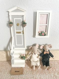 Maileg wedding mice at the door of their tiny home. Cutest fairy door and window!