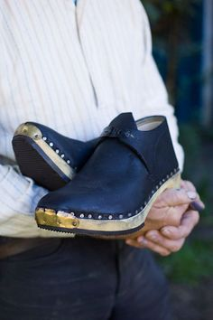 Traditional clog maker Jeremy Atkinson hand carves the wooden soles
