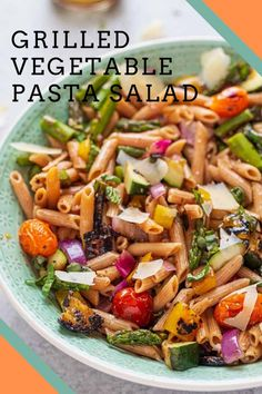 Grilled Vegetable Pasta Salad is an easy summer pasta salad packed with grilled zucchini, tomatoes, asparagus, peppers and onions in a delicious homemade vinaigrette dressing.  It's the perfect summer side dish for potlucks, picnics, hamburgers, hot dogs and everything in between!