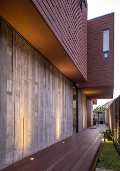 Mexican-American firm Gracia Studio has completed a family home in the city of Tijuana comprising a weathering steel volume atop a concrete ground floor