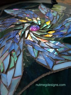 Up close look at Margaret Almon's mosaicing on the new flower design