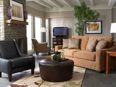 This Ryder living room set is a blend of contemporary style and luxurious textures. Covered in rich mocha leather, the Wheel ottoman can be used as a handsome cocktail table or to relax with your feet up.