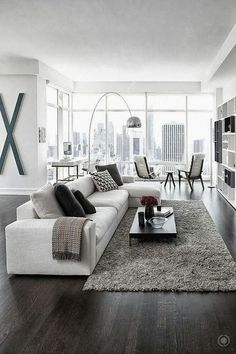Modern living room design. Clean and uncluttered but welcoming and comfortable and livable at the same time. I love the chrome floor lamp!