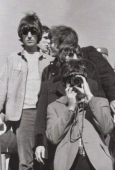 The Beatles disembark.